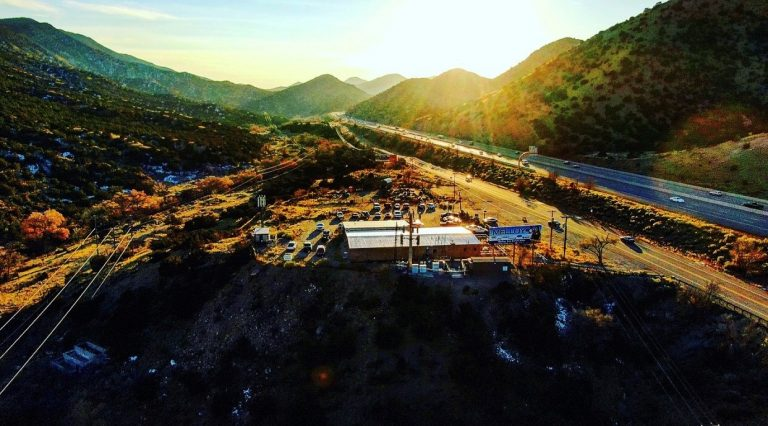 Aerial Sunset Shot of RockCanyon and Route 66 / Musical Highway